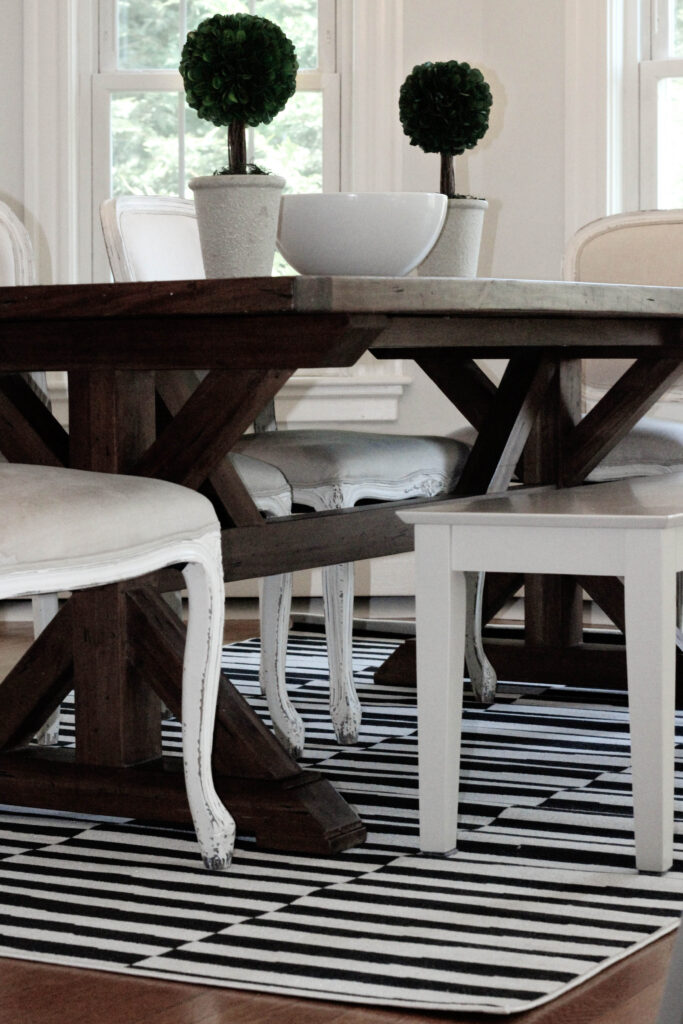 Black and White Striped Dining Room Rug with Rustic Wood Table